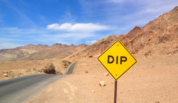 """Dip"" sign on the road in Death Valley CA."