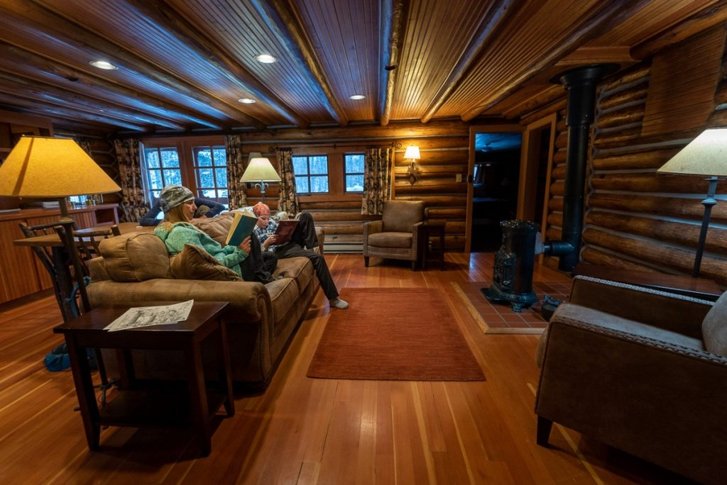 interior of a western cabin with two people reading