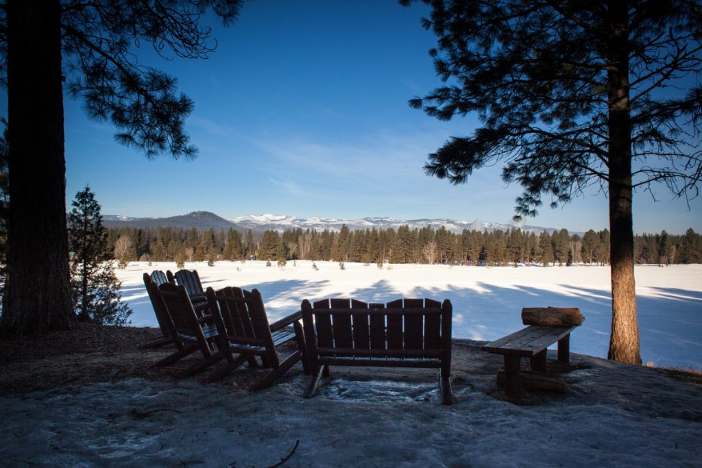 back of chairs and snowy field of cross country ski trails at Double Arrow Resort in Seeley Lake Montana