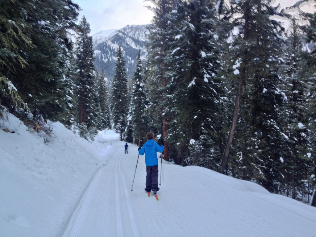 two kids cross country skiing at Lone Mountain Ranch in Big Sky Montana