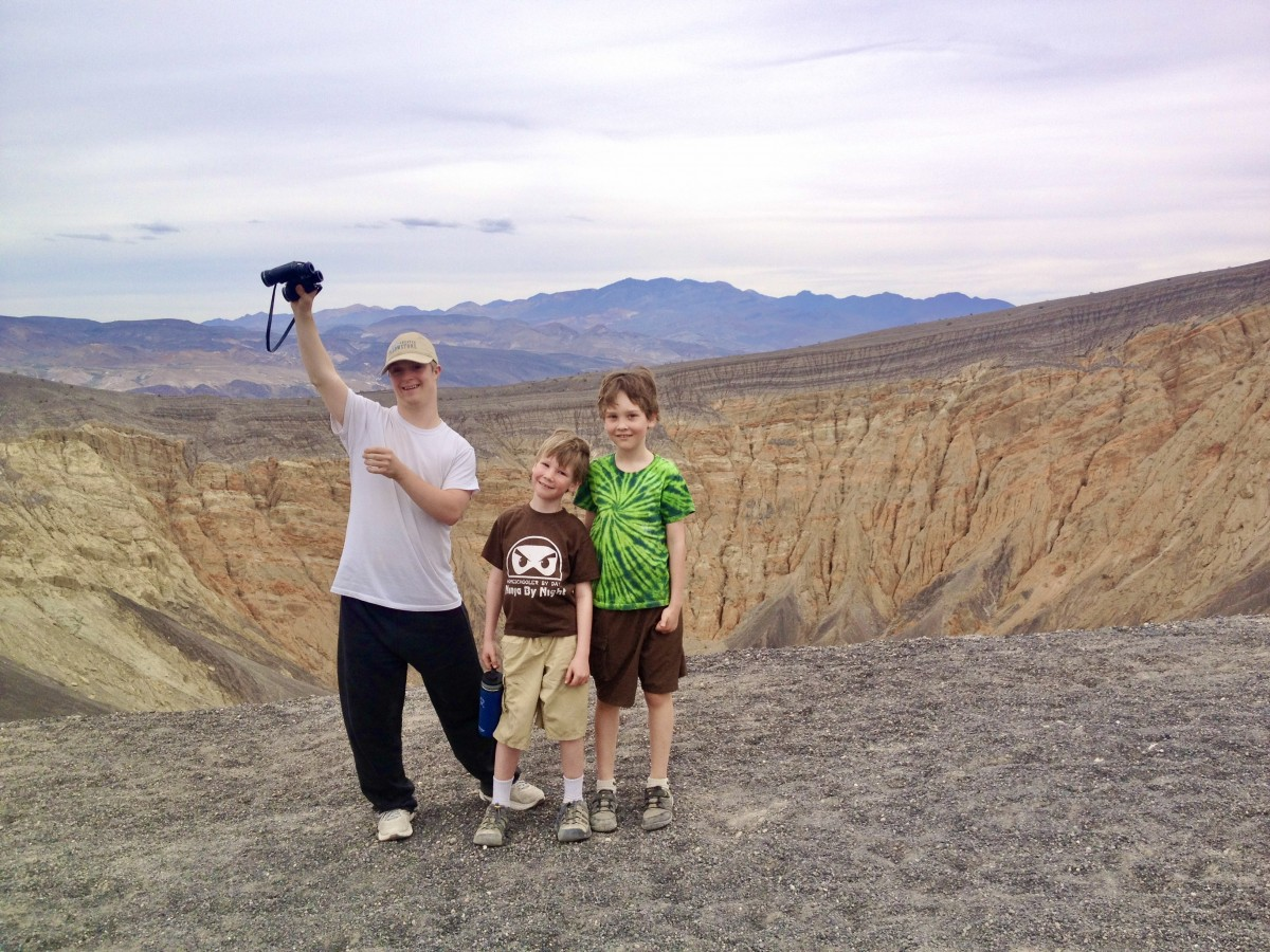 Three boys at Ubehebe Crater Death Valley National Park
