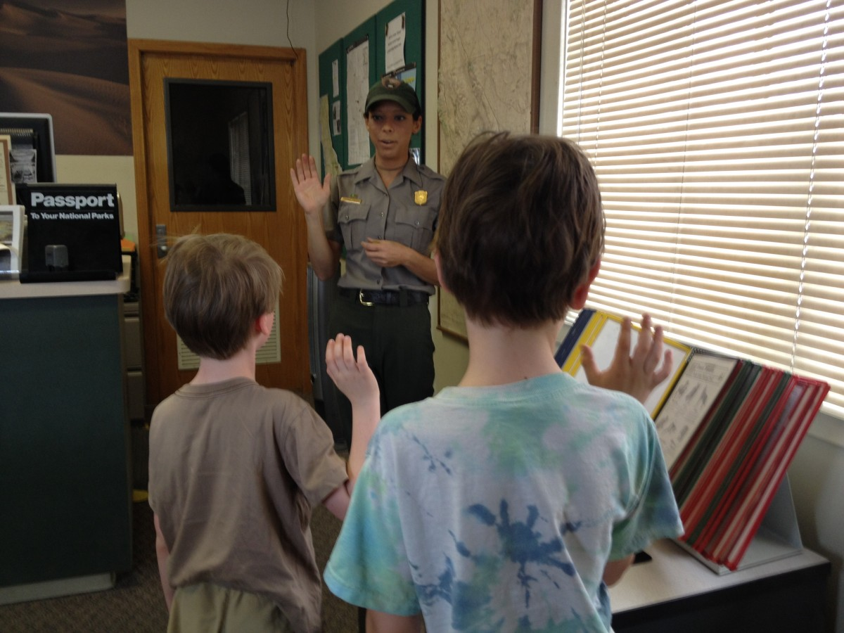 a ranger swearing in two boys to the junior ranger program in Death Valley