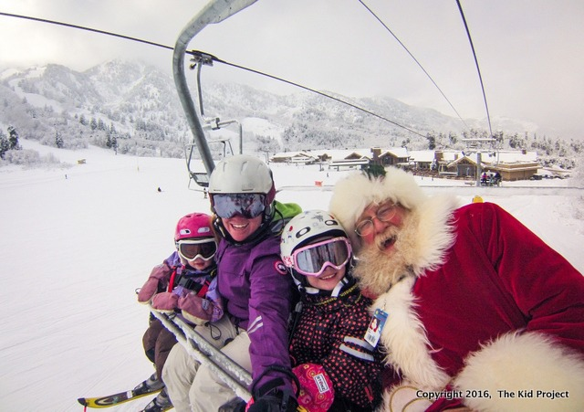 Outdoor Christmas traditions includes skiing with Santa