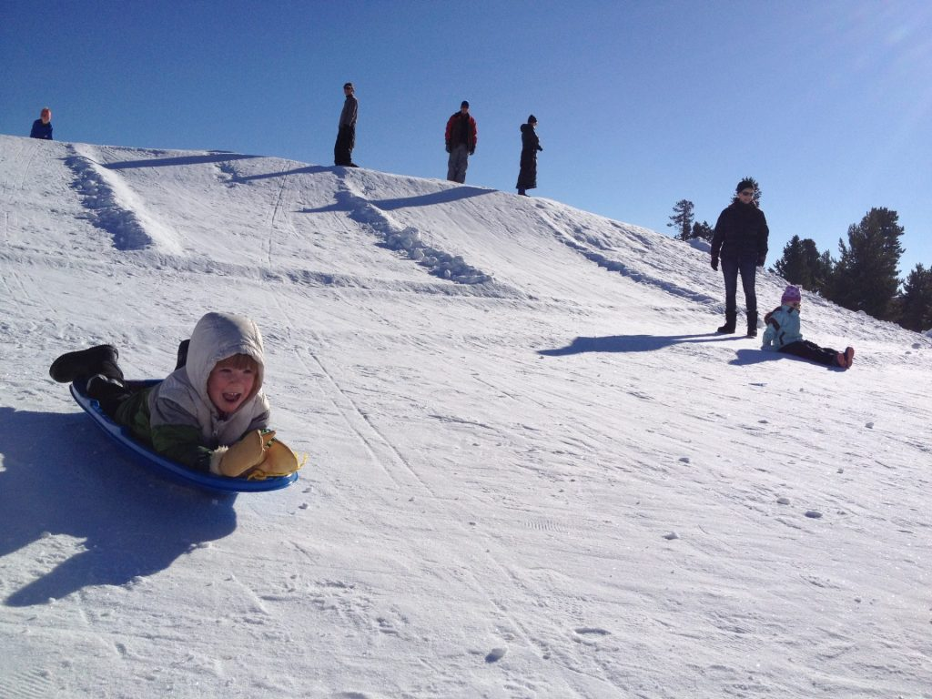 Sledding in West Yellowstone during Kids n' snow program