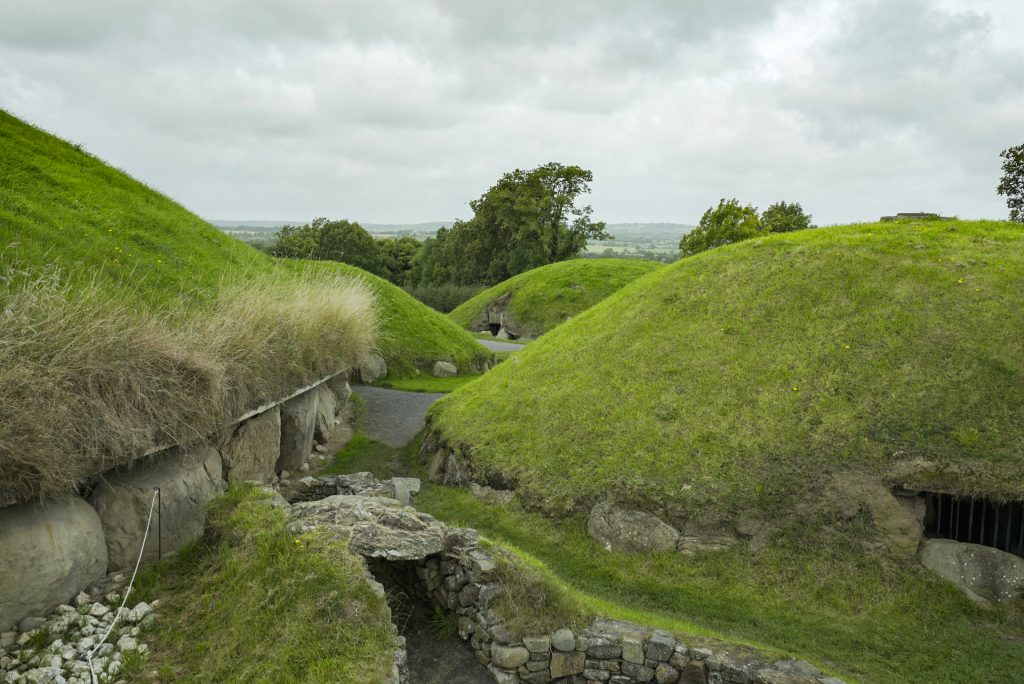 The main mound (left) at Knowth and some of the satellite burial mounds that surround it.