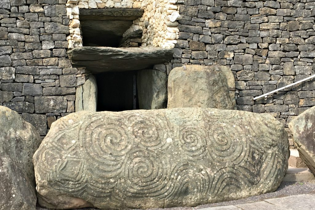 The entrance stone at Newgrange is intricately carved megalithic art.
