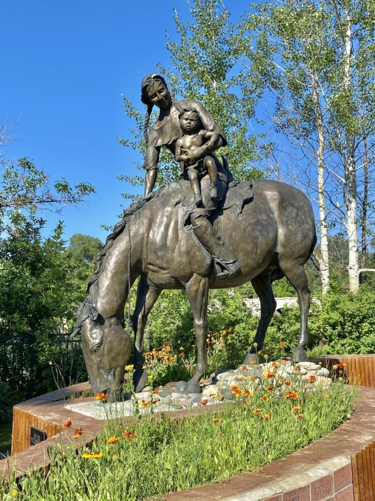 statue of Sacajawea on a horse holding her baby, Pomp