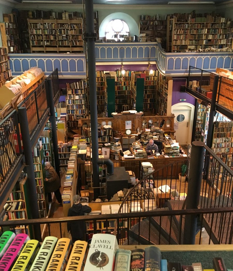 a bookstore crammed with the best books to read while traveling