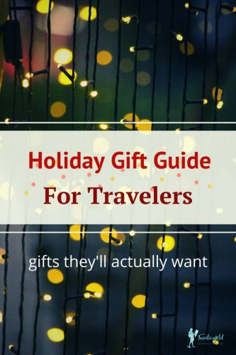 "lights in background of text reading ""Holiday Gift Guide For Travelers - gifts they'll actually want"