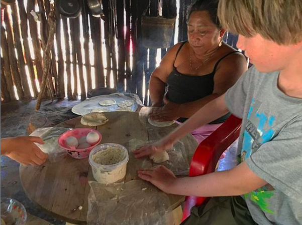 Making tortillas in a Maya hut in Mexico