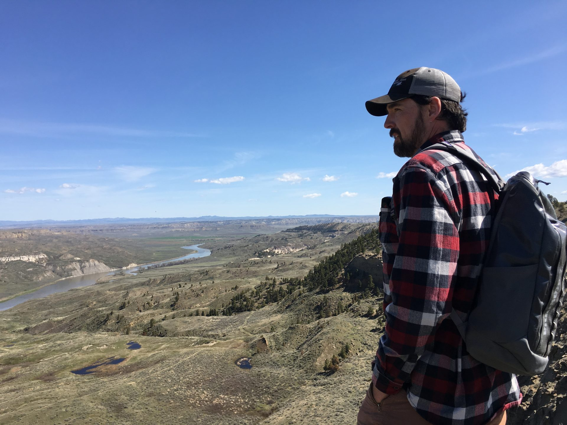 man looking over the Missouri River with Montana plains in every direction