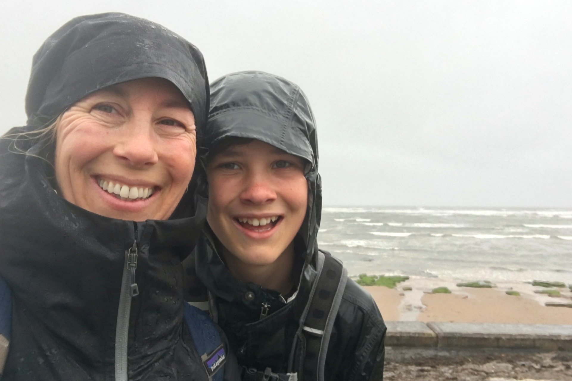 mom and son selfie in the rain on the Moray Coast Trail