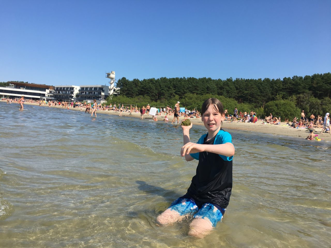 Boy throwing sand at Pirita Beach in Tallinn