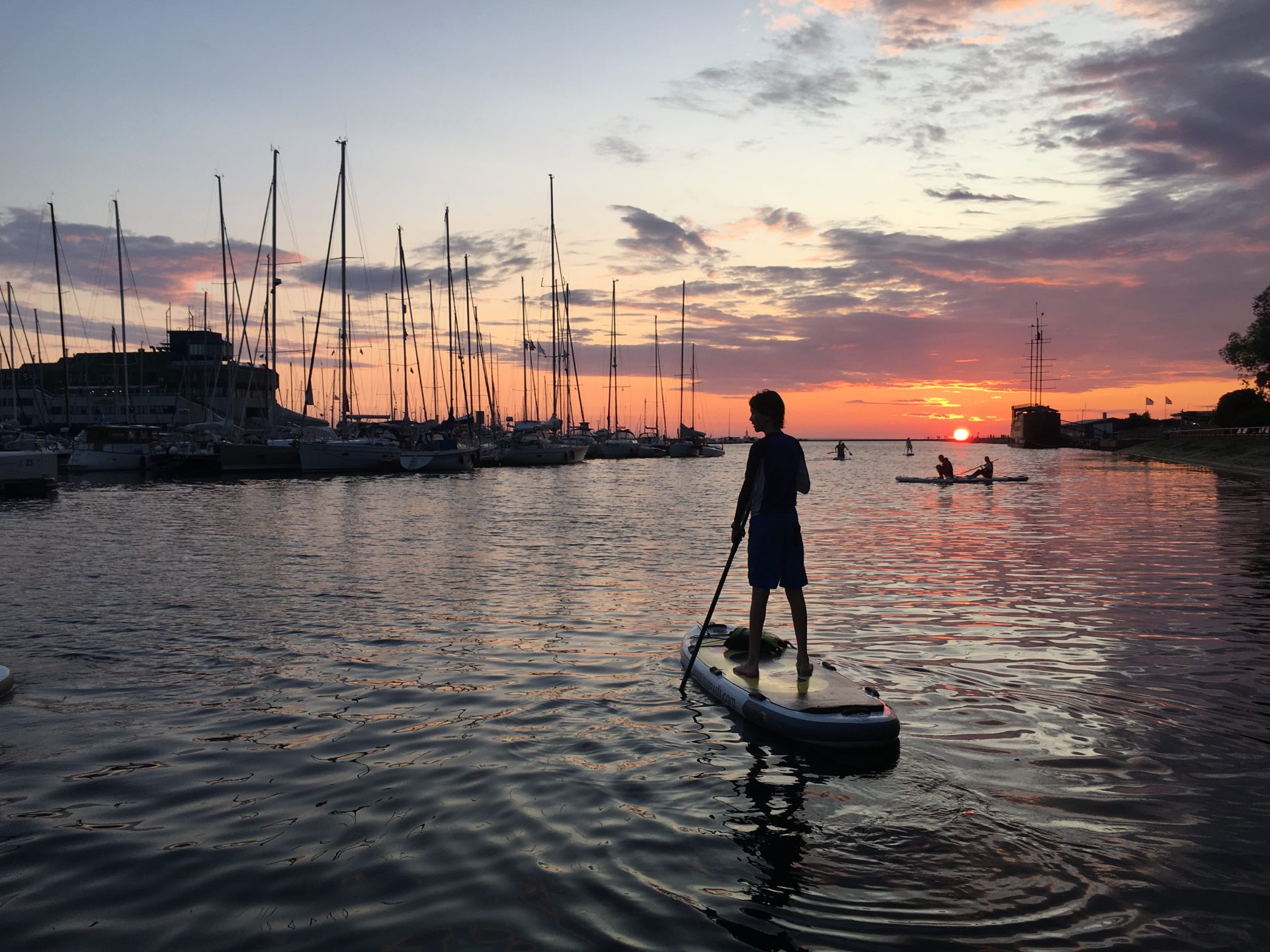 Tallinn sightseeing should include paddleboarding into the sunset