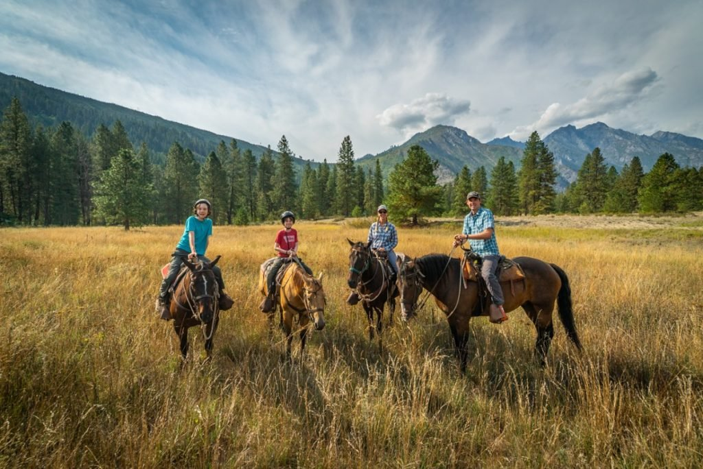 Four people horseback riding near Leavenworth Washington