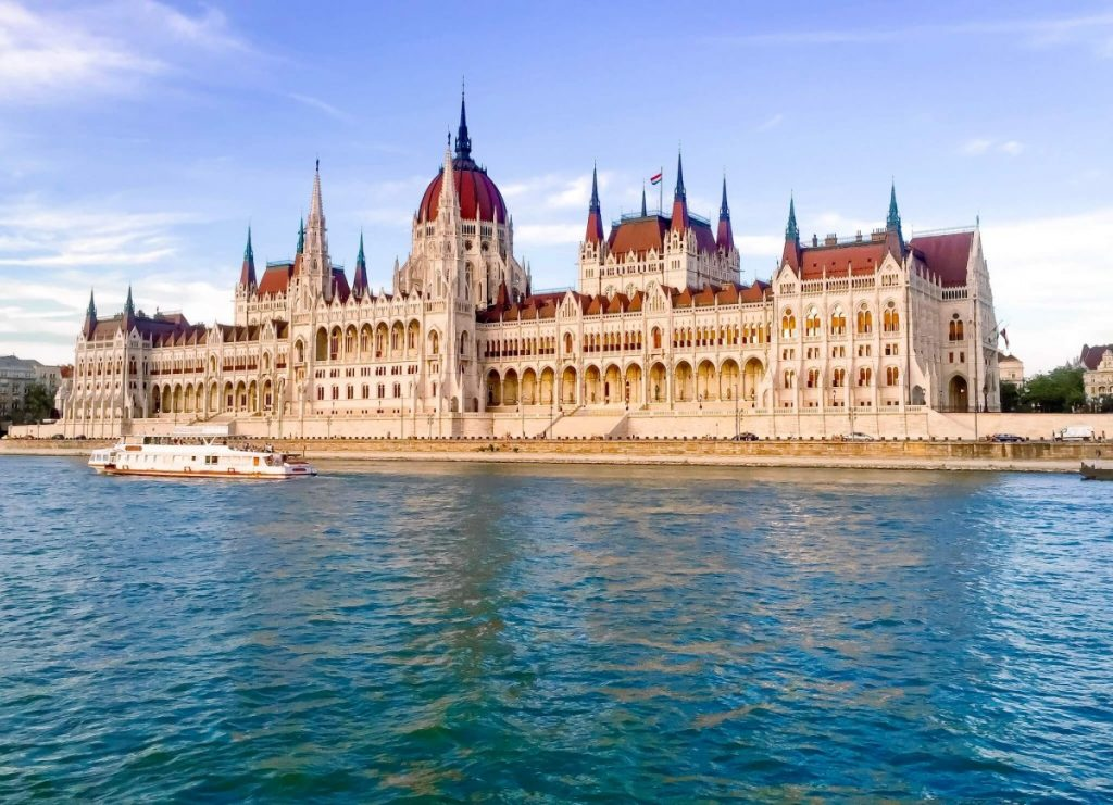 Ornate building and river, Parliament Building in Budapest from the Danube River