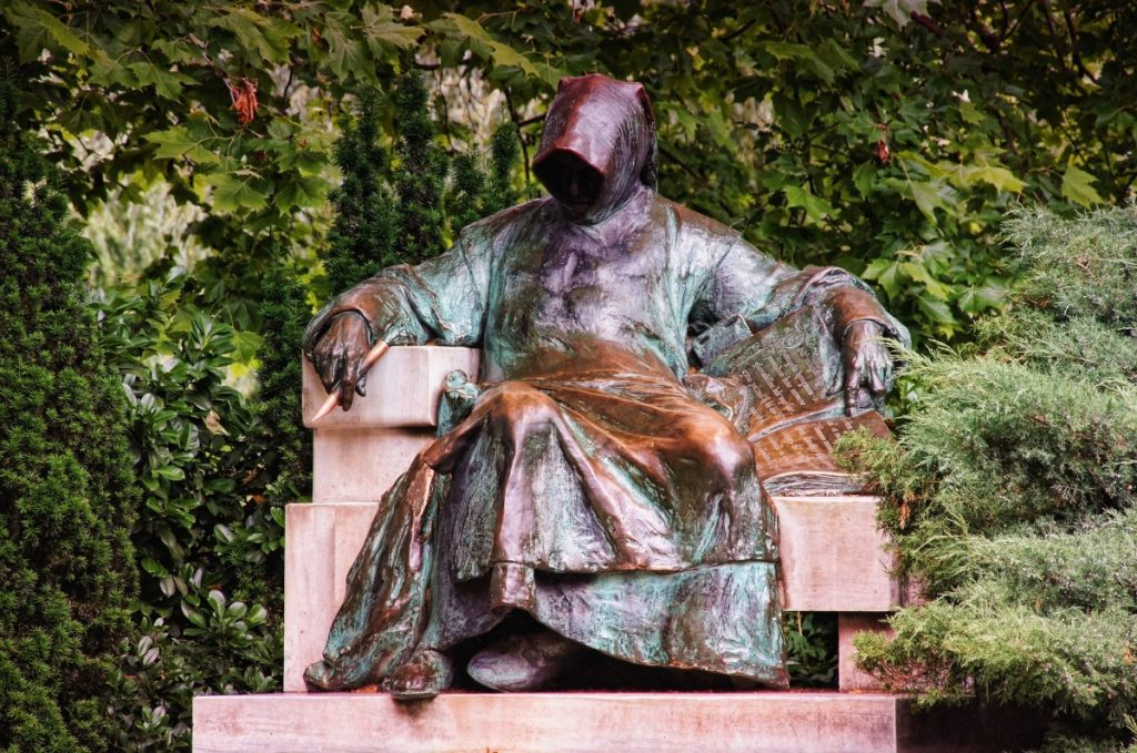Bronze statue of monk in City Park in Budapest Hungary