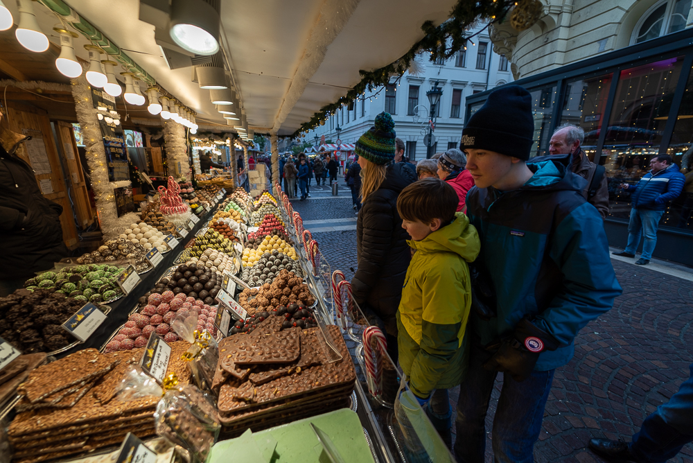 Budapest Christmas Market stall with three people looking