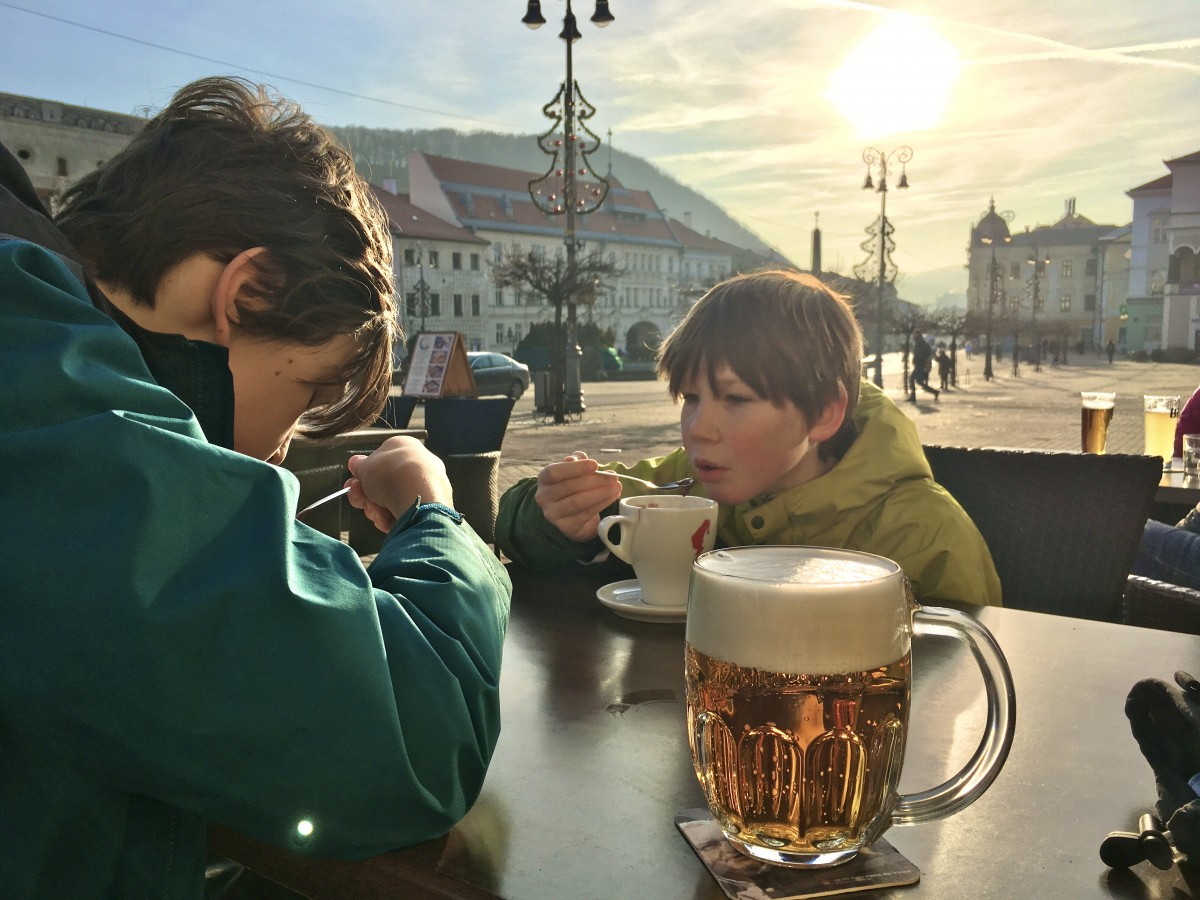 boys drinking hot chocolate in the square in Banska Bystrica Slovakia