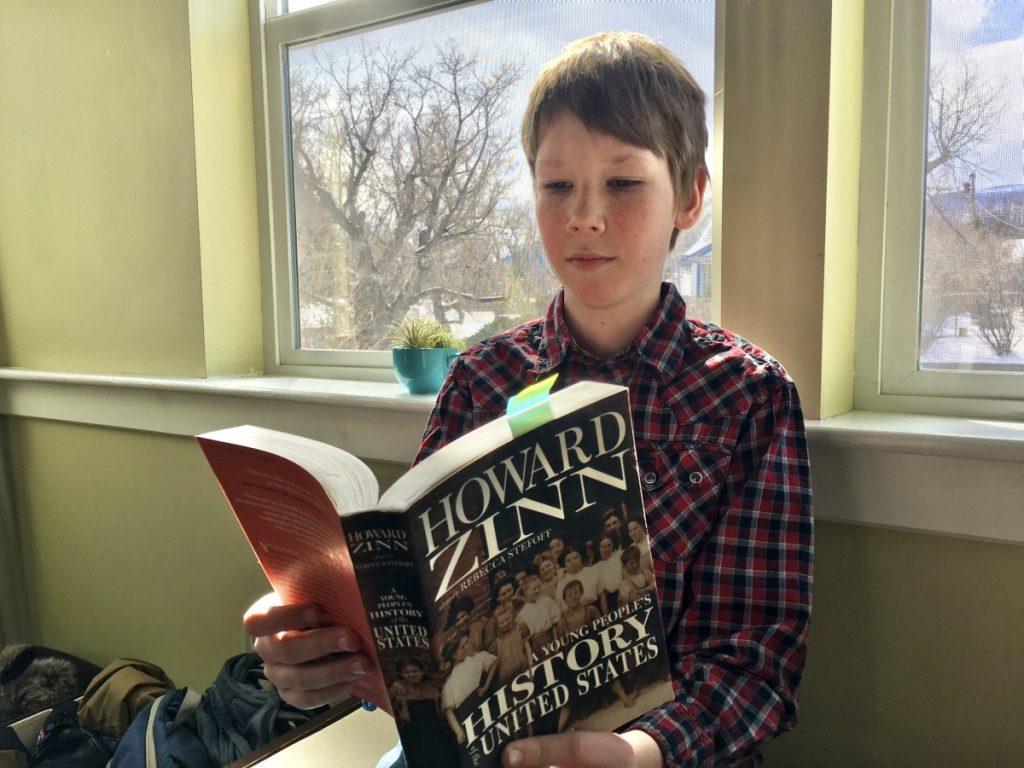 boy reading homeschool history curriculum