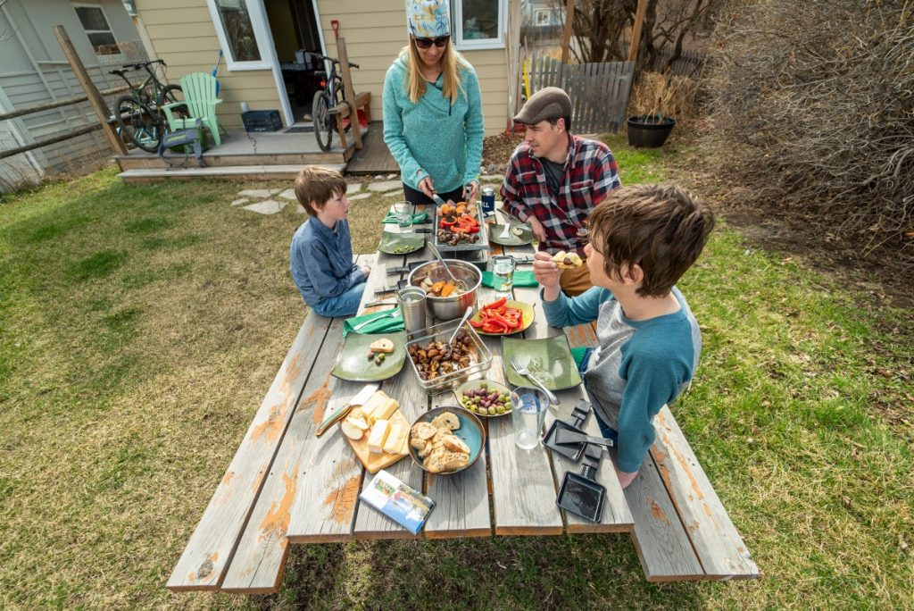 Swiss travel themed party family around picnic table