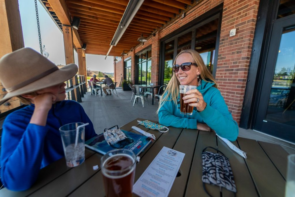 Holding a beer in Lewistown on an Montana road trip
