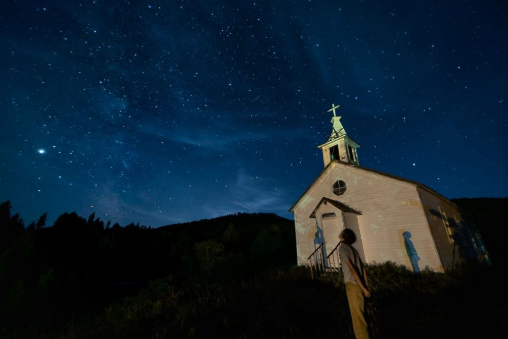 Starry night sky and a church Montana off the beaten path