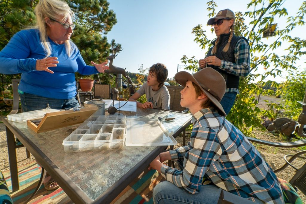 kids learning out fossils outdoors in montana