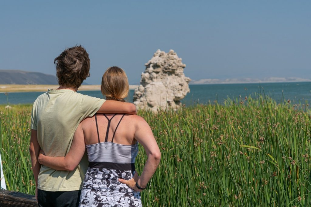mono lake tufa with the backs of two people, top attractions on hwy 395