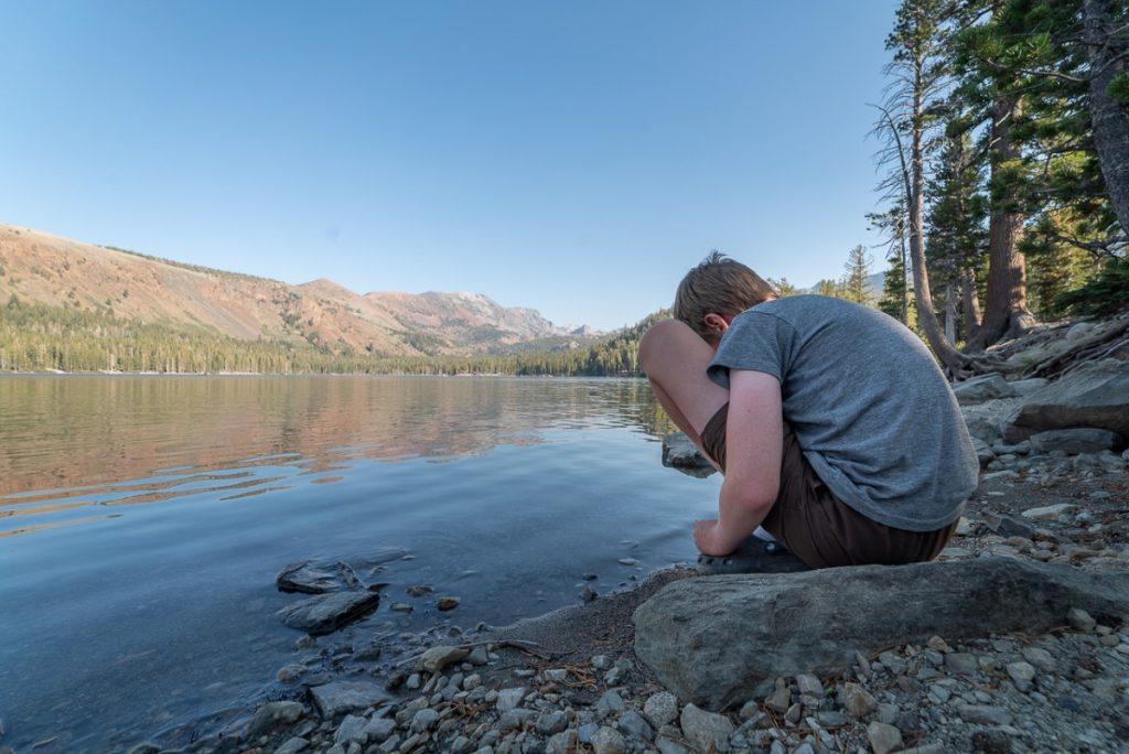 boy by a lake