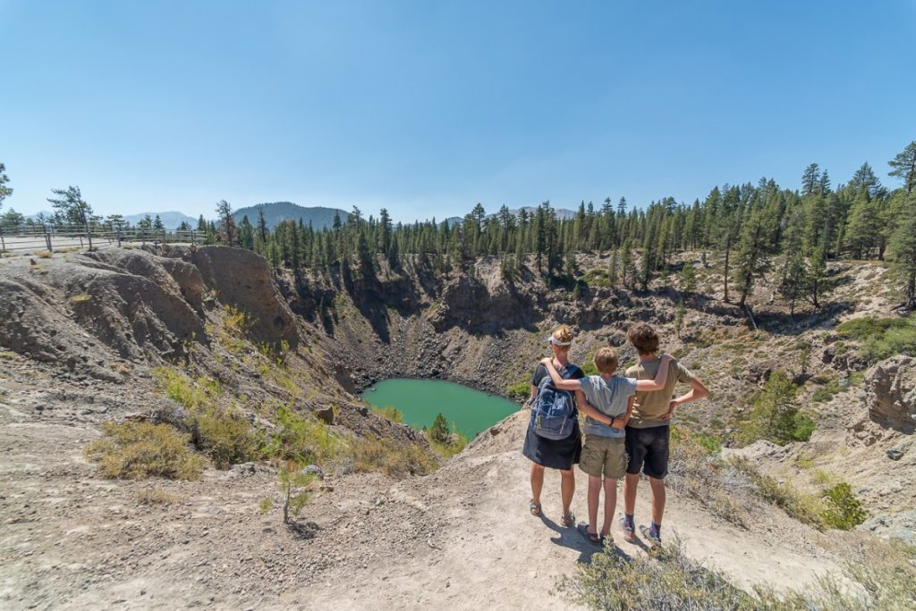 three people looking at a crater with turquoise water, Road Trip Ideas: Highway 395 California