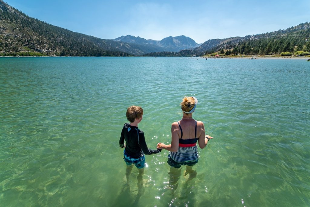 two people standing in June Lake at the June Lake Beach