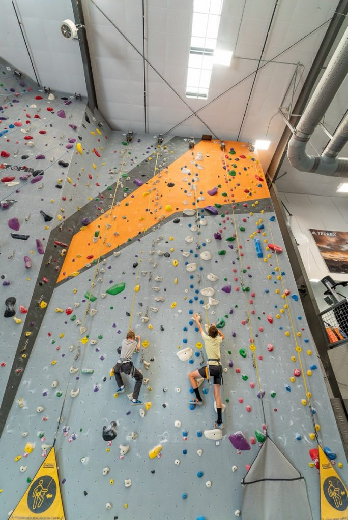 two kids climbing a wall at an indoor climbing gym in Billings