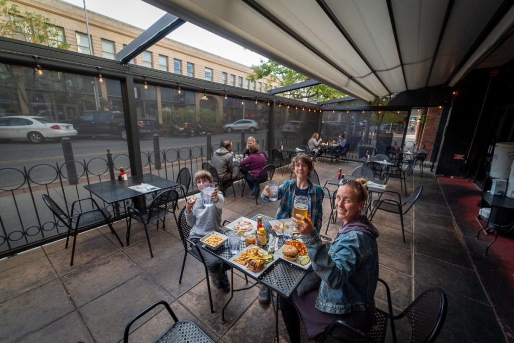 family eating dinner on a patio at a restaurant outdoor eating Billings