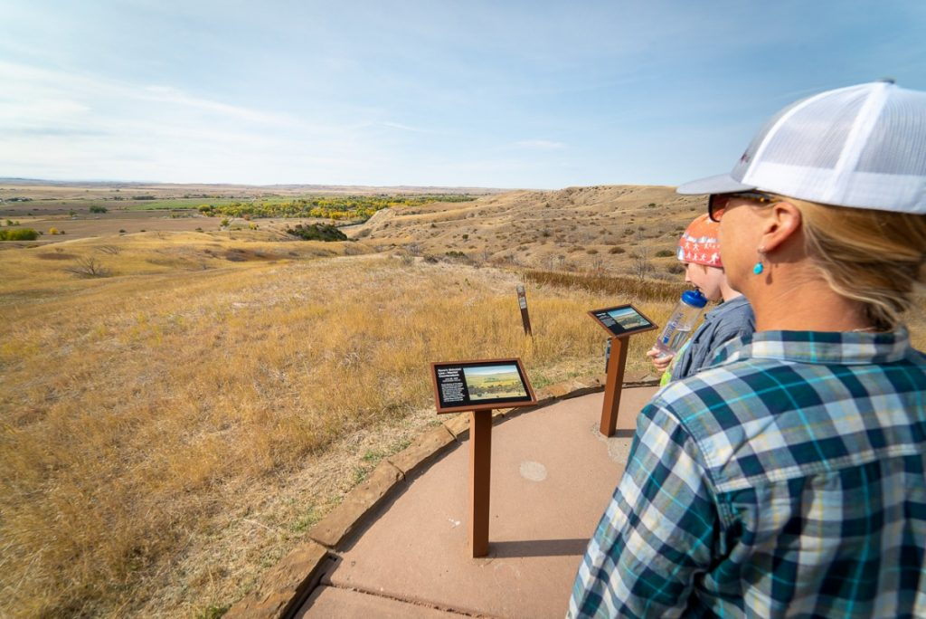 family looking at interpretive signs at Little Bighorn Battlefield in Montana