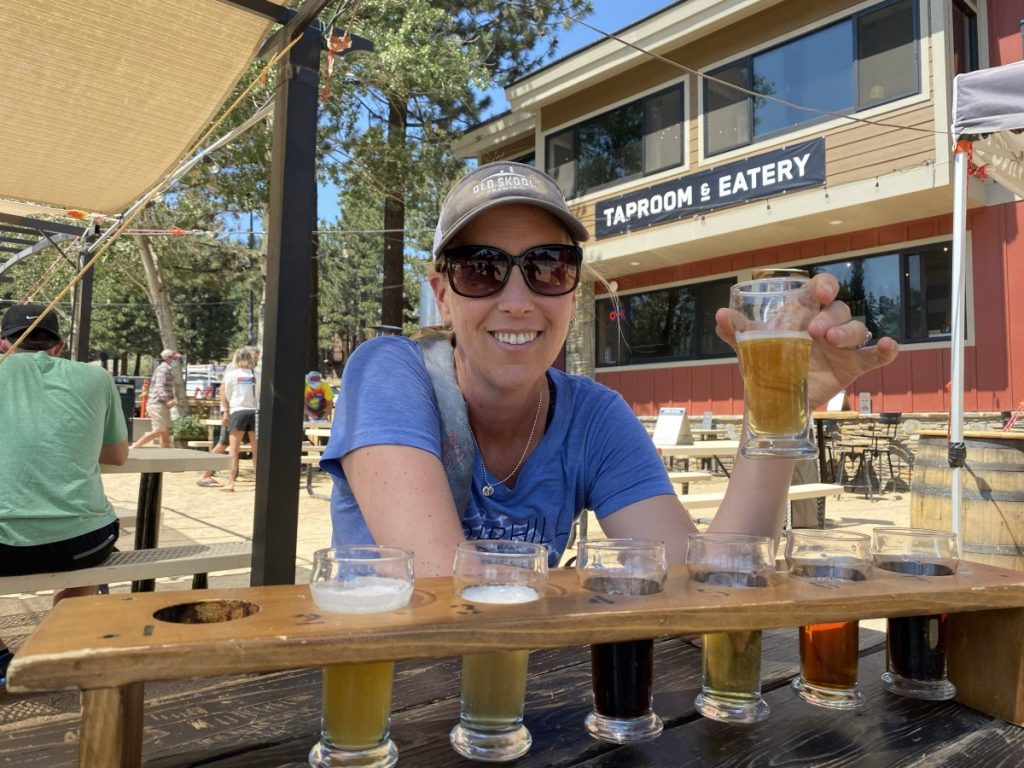 woman tasting a flight of beer in Mammoth California off Highway 395 road trip