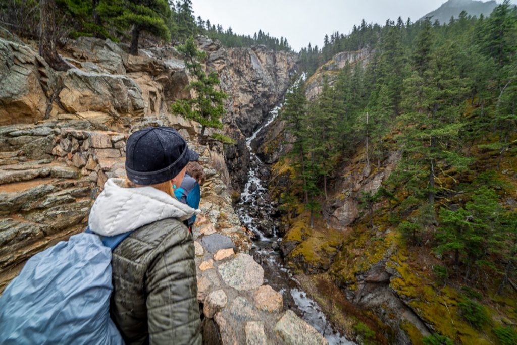 woman looking at woodbine waterfall