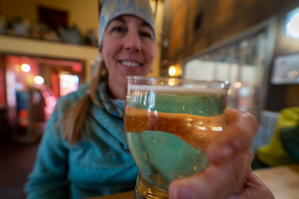 woman holding glass of cider at Red Lodge Ales