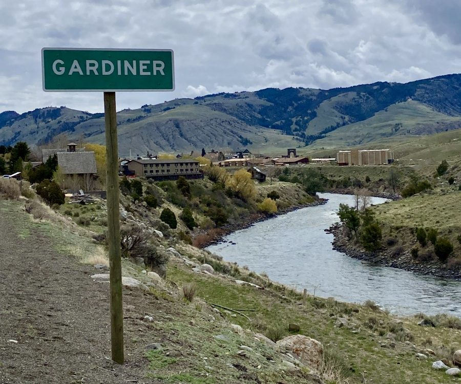 sign for Gardiner Montana with Yellowstone River below