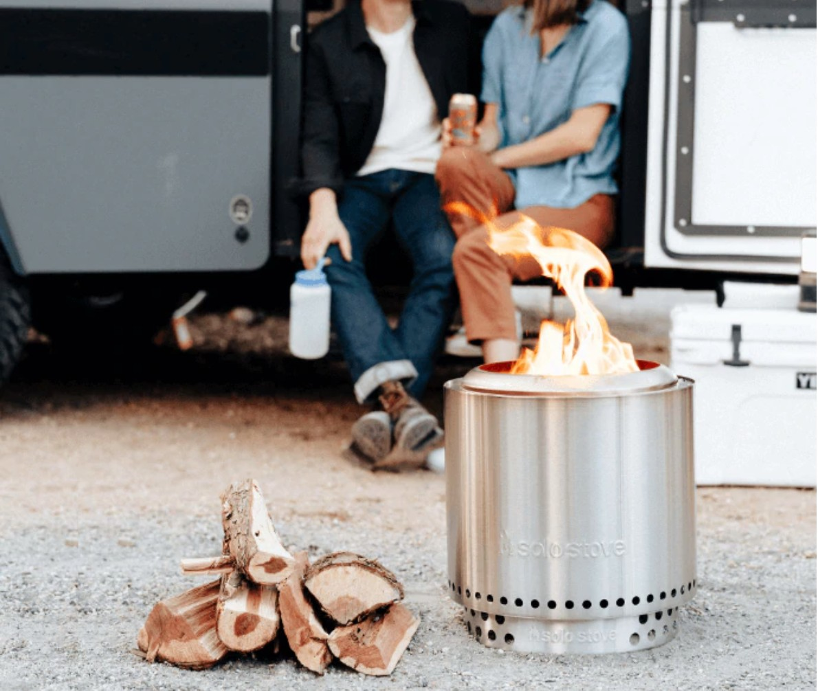 Solo Stove campfire in front of an camper