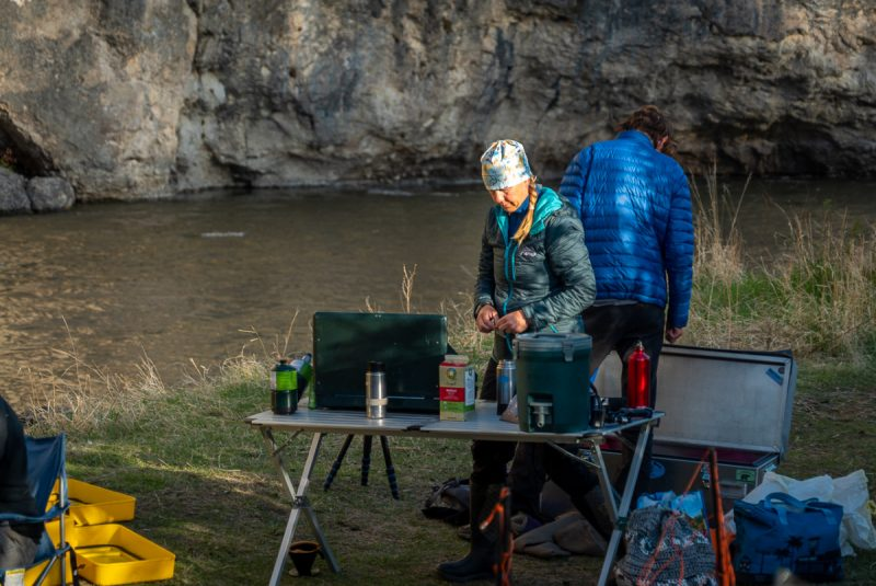 Woman cooking breakfast on Smith River