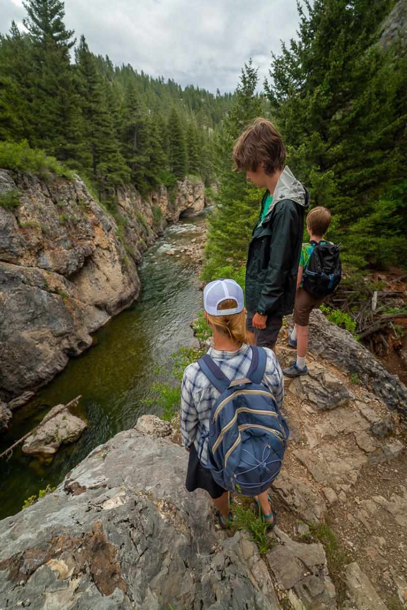 Three people looking at Belt Creek in Sluice Boxes State Park