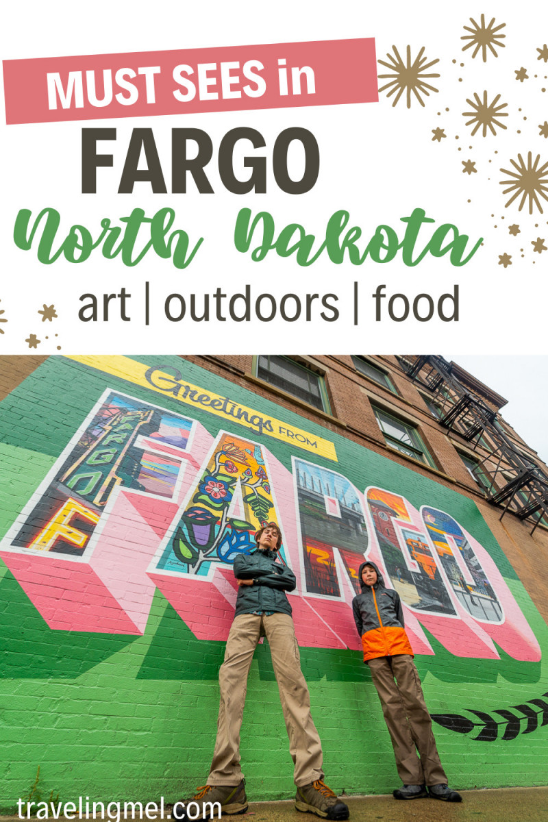 """Picture of a mural with two people in front of it and text reading"""" Must Sees in Fargo North Dakota, Art, outdoors, food"""