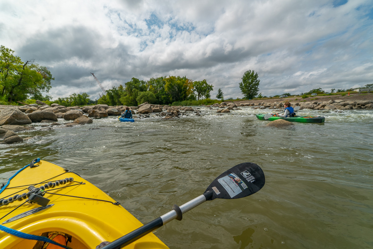 kayaking in riffles on the red river north dakota and minnesota
