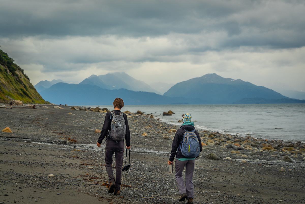 walking on a beach in Alaska while talking about must read Alaska books