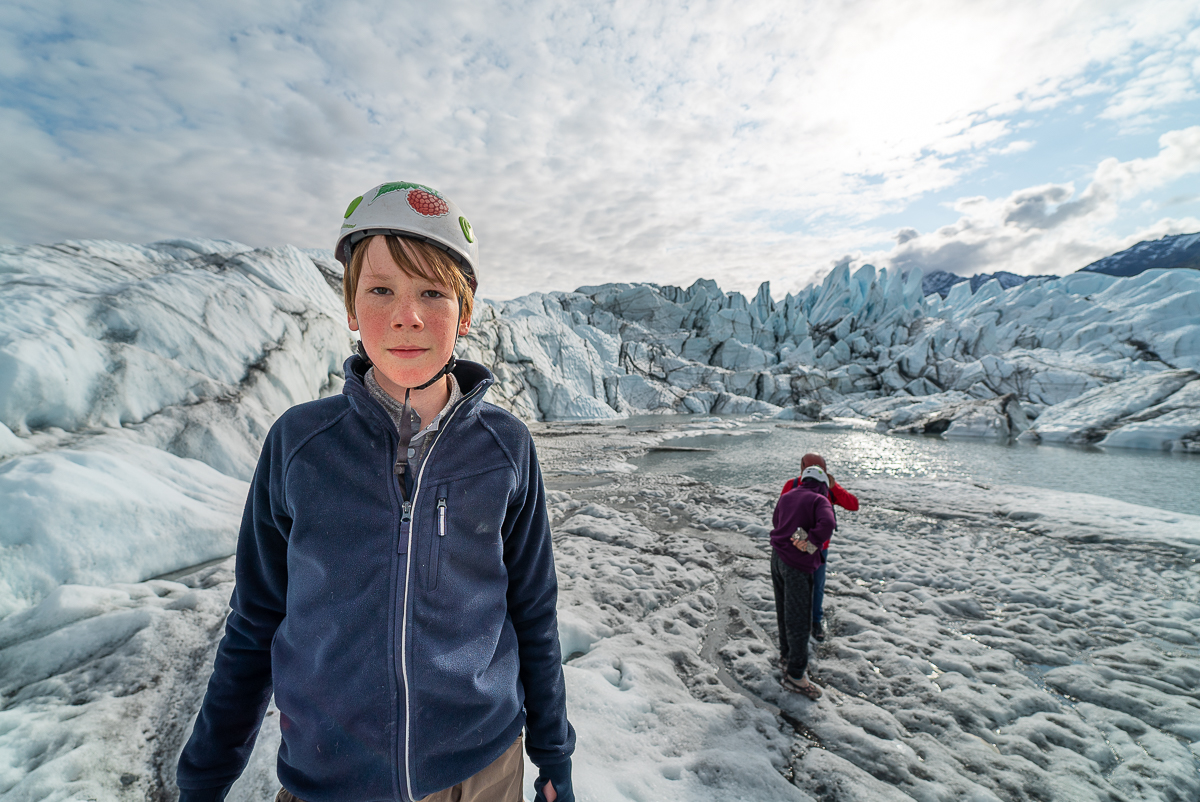 boy walking on Matanuska glacier with Salmon Berry Tours in Anchorage