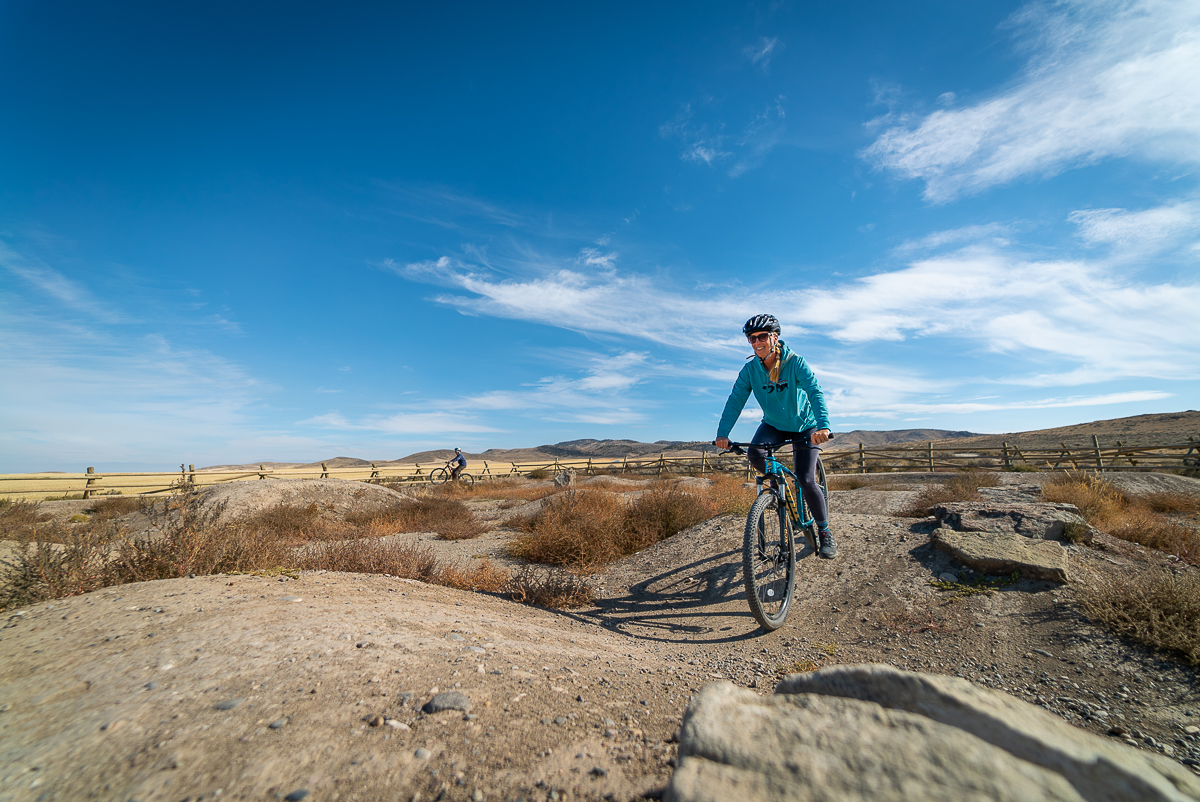 woman mountain biking near Bozeman Montana
