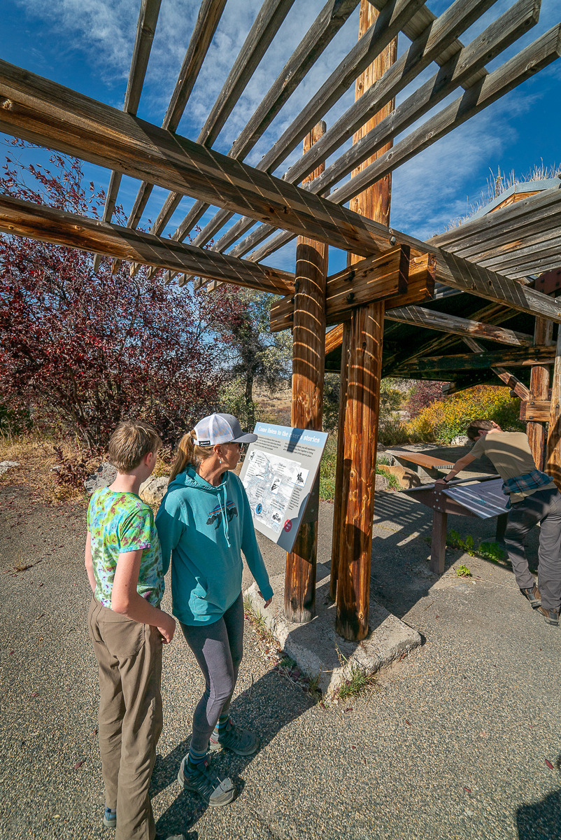 reading interpretive signs at Missouri Headwaters State Park